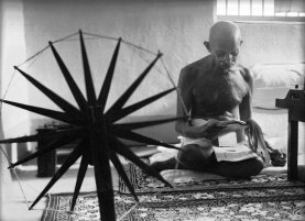Gandhi Reading at Spinning Wheel