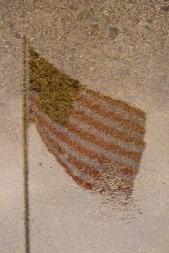 United States flag reflection in water